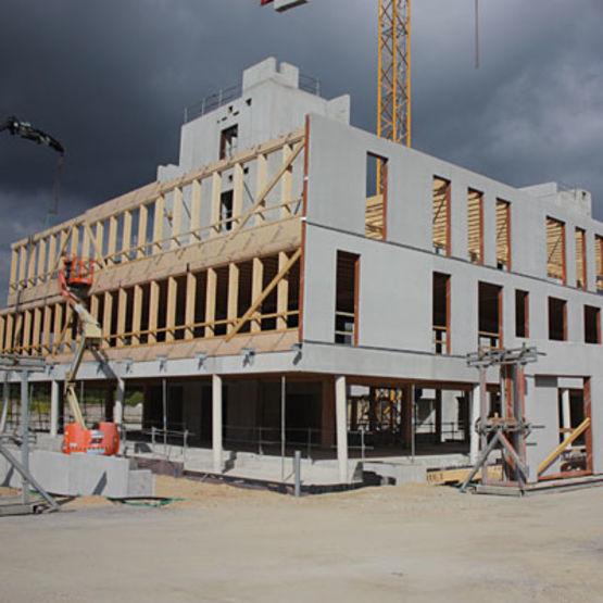 Fa ade mixte bois b ton proc d fmb sbb for Construction en bois ou beton