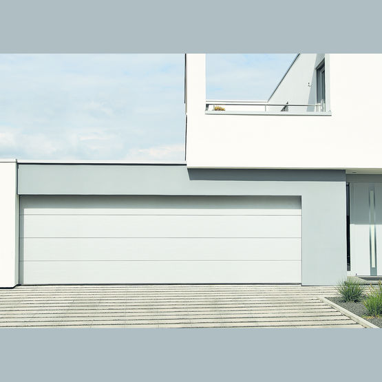 Porte de garage double sectionnelle h rmann jusqu 39 5 5 m tres for Double porte de garage