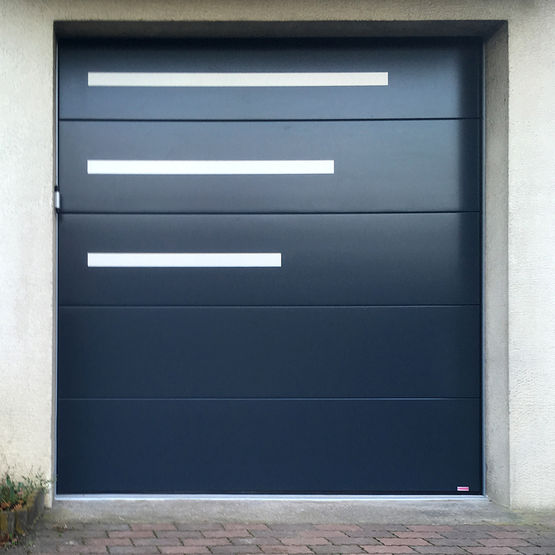 Portes de garage sectionnelle isolante blanche ou aspect for Porte de garage fame