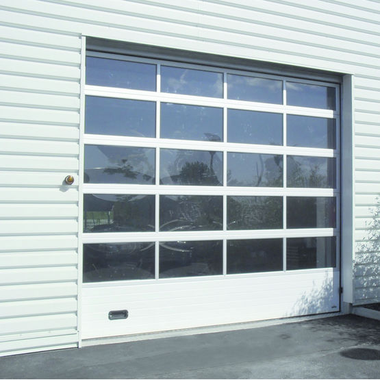 portes sectionnelles vitr es pour milieux industriels porte sectionnelle industrie vitr e la. Black Bedroom Furniture Sets. Home Design Ideas